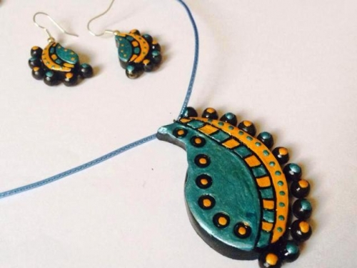 Terracotta mango pendent with earring Created By  Posted By N Studio